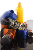 Oil Filters. A pile of used oil filters and containers spilling on everything, Where is your oil going Royalty Free Stock Photos