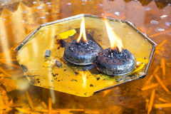 Oil flame lamp in Thai temple Royalty Free Stock Photography