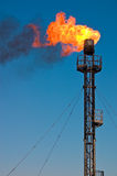 Oil flare. Burning emergency oil gas flare Royalty Free Stock Photography