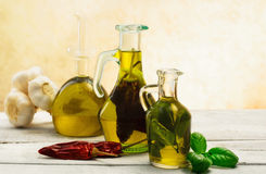 Oil flavored with herbs abd spices Royalty Free Stock Photos
