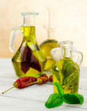 Oil flavored with herbs and spices Stock Photos