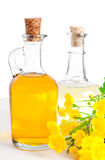 Oil with a flower buttercup Stock Image