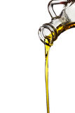 Oil flowing from carafe Royalty Free Stock Image
