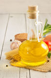 Oil and food ingredients, spice on wood Stock Image