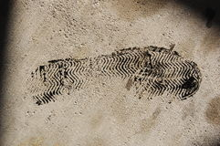 Oil Footprint. A tennis shoe sole with oil on cement Stock Images