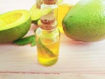 Oil, fresh avocado summer on a wooden background on a wooden background royalty free stock photos