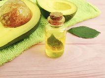 Oil, fresh avocado on a wooden background on a wooden background royalty free stock images