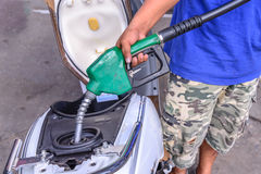 Oil fueling to motorcycles.  stock photo