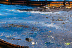 Oil and garbage pollution in the water. Stock Photos