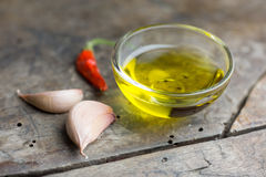 Oil garlic and chili on table Royalty Free Stock Photography