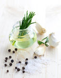 Oil, garlic, pepper and salt. Olive oil, garlic, pepper and salt on table stock photos