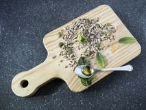 Oil, garlic, pumpkin seeds and mint, on kitchen table royalty free stock images