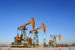 Oil and gas. Oil derrick pumps oil or natural gas from underground stock photography