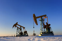 Oil and gas. Oil derrick pumps oil or natural gas from underground royalty free stock photo