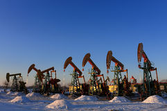 Oil and gas. Oil derrick pumps oil or natural gas from underground royalty free stock photos