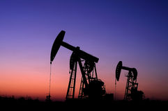 Oil and gas. Oil derrick pumps oil or natural gas from underground Royalty Free Stock Photography