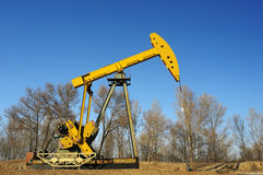 Oil and gas. Oil derrick pumps oil or natural gas from underground stock images