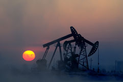 Oil and gas. Oil derrick pumps oil or natural gas from underground stock image
