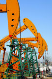 Oil and gas. Oil derrick pumps oil or natural gas from underground royalty free stock images