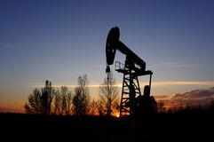 Oil and gas. Oil derrick pumps oil or natural gas from underground Stock Photos