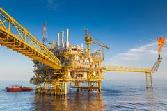 Oil and gas central processing platform produced gas for sent to onshore refinery and oil sent to storage tank or tanker.  Stock Images