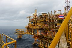 Oil and Gas central processing platform and remote platform pro. Duced natural gas and liquid condensate for set to onshore refinery in morning scene background royalty free stock photography
