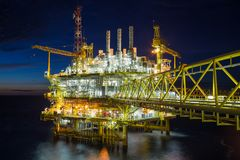Oil and gas central processing platform in sun set in the gulf of Thailand, Oil and gas petroleum business.  Royalty Free Stock Photos
