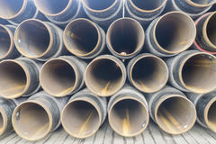 Oil and gas. Concrete rounded pipes stacking on deck for underwater oil and gas purpose Stock Images