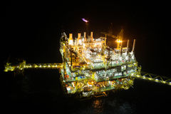 Oil and gas construction in night view. View from helicopter night flight. Oil and gas platform in offshore. Royalty Free Stock Images