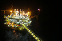 Oil and gas construction in night view. View from helicopter night flight. Oil and gas platform in offshore. Stock Photo