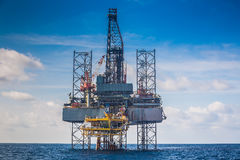 Oil and gas drilling rig just completion on oil and gas wellhead platform for new wellhead platform Royalty Free Stock Images