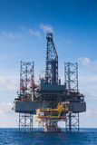 Oil and gas drilling rig work over remote wellhead platform to completion oil and gas produce well Royalty Free Stock Photography