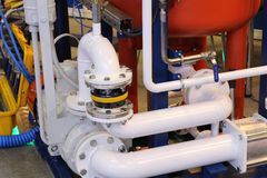 Oil and gas equipment at the plant. Pipes through which gas flows. Oil and gas industry. Production stock photos