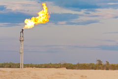 Oil gas flare. Picture of oil gas flare, sky and clouds Stock Photos
