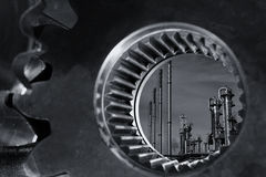 Oil and gas through a giant gear axle stock photos