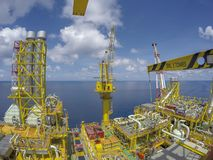 Oil and gas industry. Aerial view process area of oil and gas platform in the middle of the sea with blue sky Stock Image
