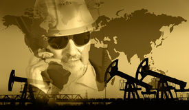 Oil and gas industry background. Pump jack group, global map, worker in a oil industry background. Double exposure. Toned sepia royalty free stock photography