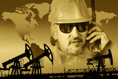 Oil and gas industry background. Pump jack group, global map, worker in a oil industry background. Double exposure. Toned sepia stock image