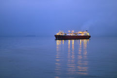 Oil and gas industry - grude oil tanker. Tanker crude oil carrier ship designed for transporting grude oil near jetty Royalty Free Stock Photos