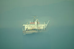 Oil and gas industry - grude oil tanker. Tanker crude oil carrier ship designed for transporting grude oil in a mist Royalty Free Stock Photography