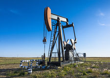 Oil and Gas Industry. A Pump Jack in an oilfield in Southern Alberta Stock Photo
