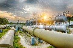 Oil and gas industry refinery factory at sunset Stock Photos