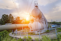Oil and gas industry refinery factory at sunset Stock Image