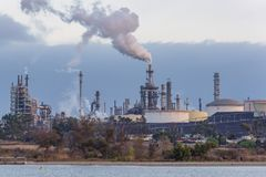 Oil and gas industry refinery near lake. Petrochemical plant in city of Los Angeles near Lake Machado Stock Photo
