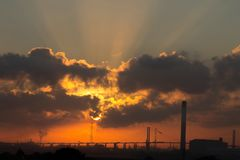 Oil and gas industry - refinery at sunrise. Factory Royalty Free Stock Images