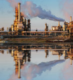 Oil and gas industry - refinery at twilight. Oil and gas refinery at twilight with reflection - factory - petrochemical plant Stock Photos