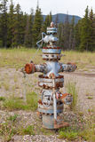 Oil gas industry wellhead flange gear locked shut Stock Photo