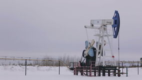 Oil and gas industry. Work of oil pump jack on a stock video footage
