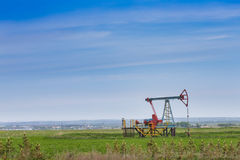 Oil and gas industry. Work of oil pump jack on a field Stock Images