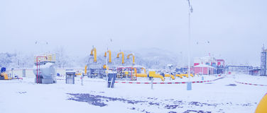 Oil/gas pipeline in sonwing. A heavy snow night, I in the work place, of natural gas pipeline royalty free stock photography